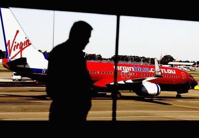 Australia watchdog signs off Etihad-Virgin Blue alliance