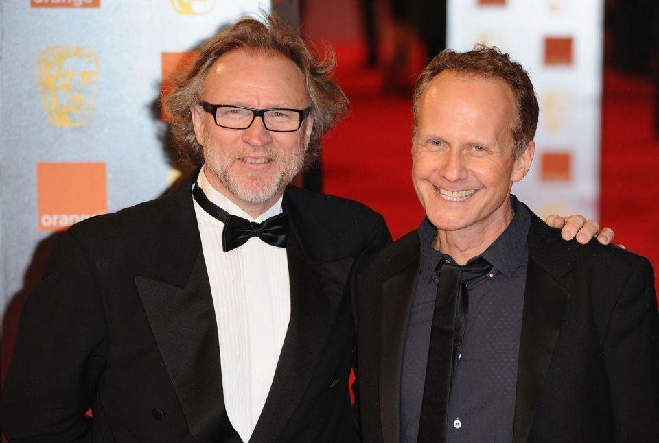 Men in black rock BAFTA's red carpet