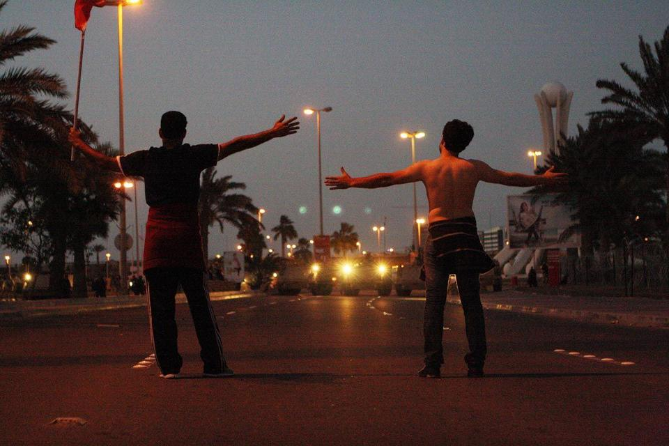 Bahrain army withdrawn, police attack protesters
