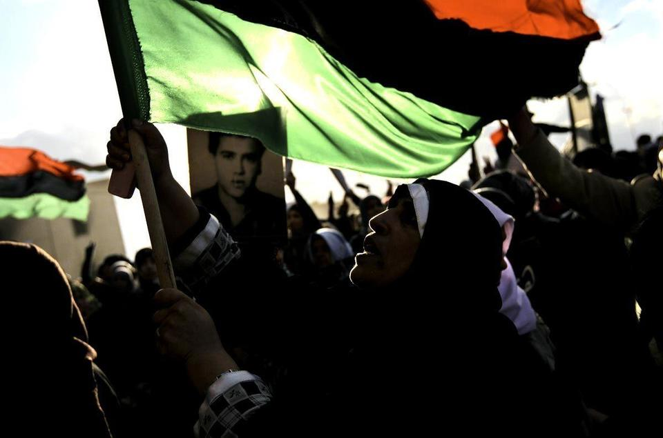 Armed Gaddafi opponents take town west of Tripoli