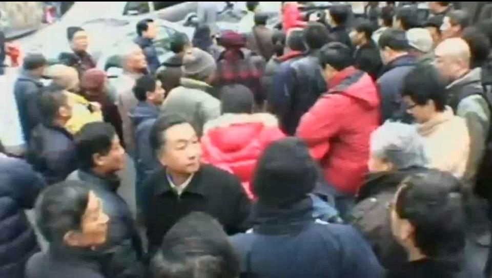 Protesters take to streets of Shanghai, spurred by Arab uprisings