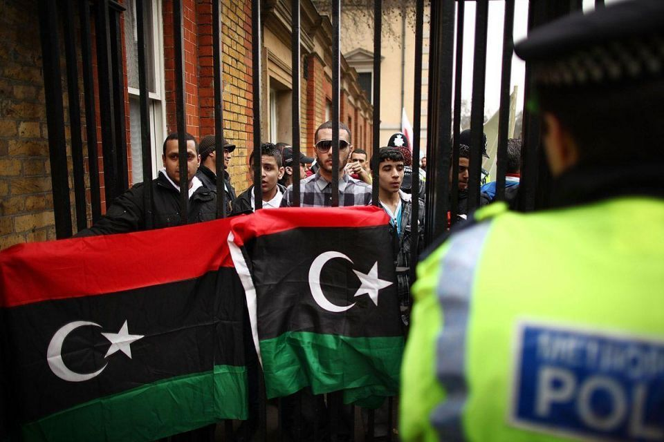 Protesters rally as world leaders mull Libya plan