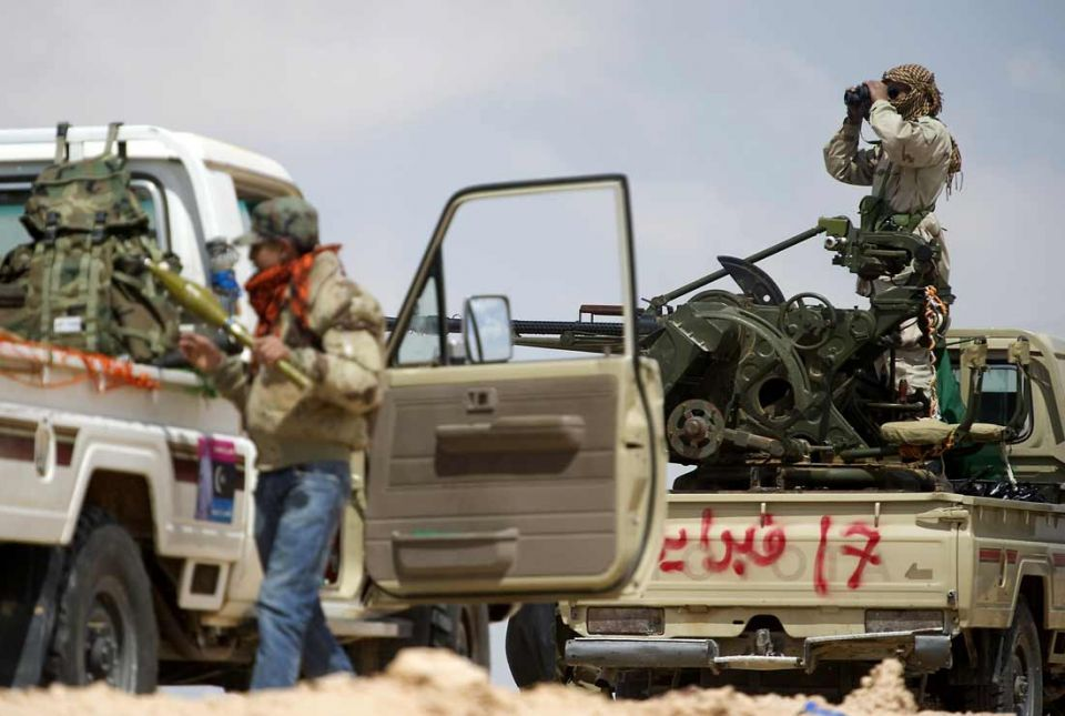 Rebels clash with pro-Gaddafi forces