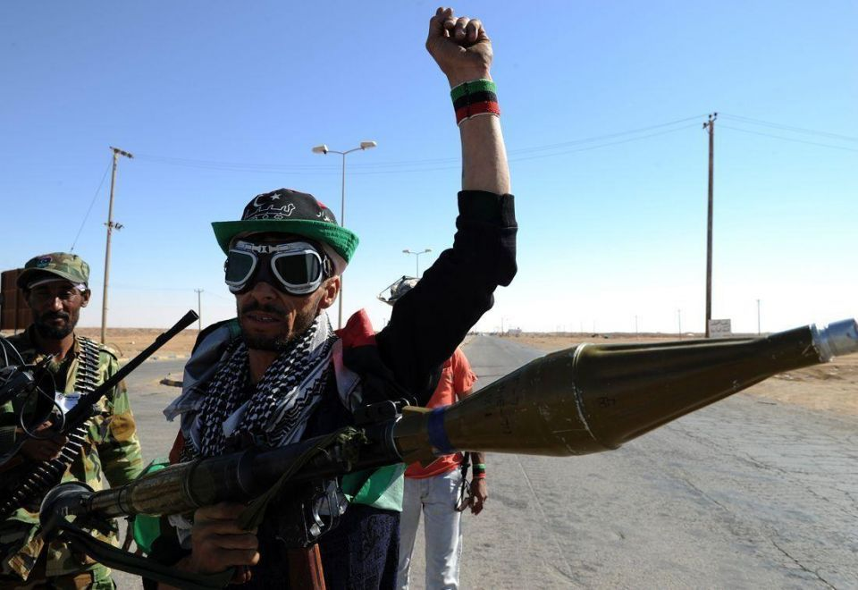 Gaddafi troops surround Libyan city after deadly clashes