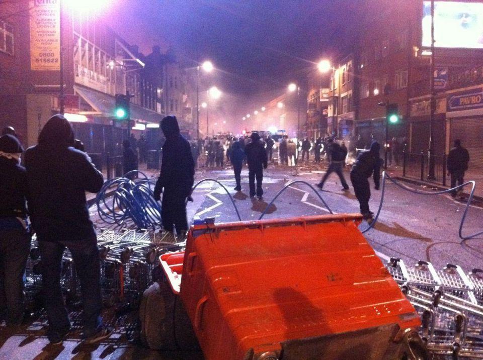 Crowds attack police, burn cars after UK protest