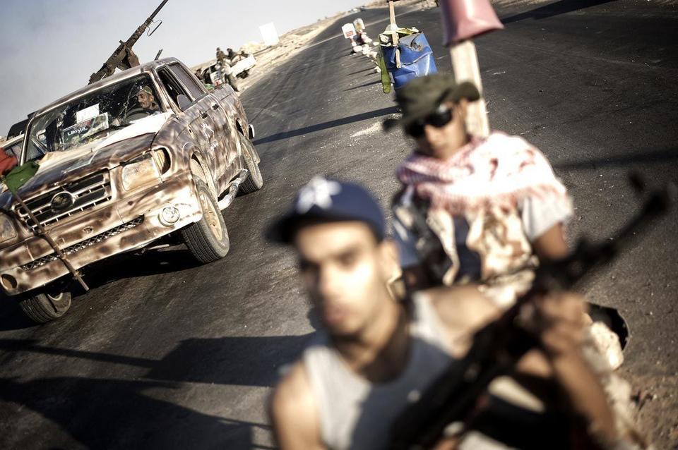 Bounty on Gaddafi's head as battle goes on