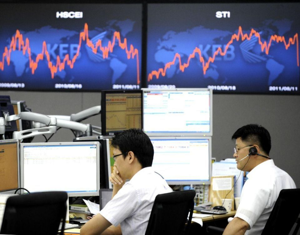 Dollar holds some gains made on Kim Jong-il death
