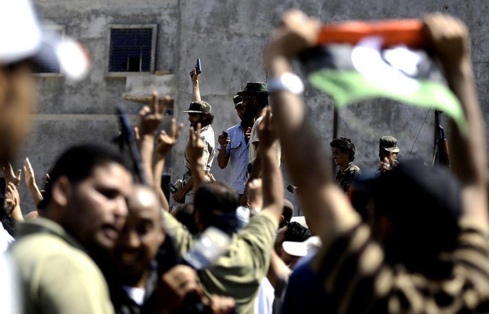 Libyan rebels converge on Sirte in Gaddafi manhunt