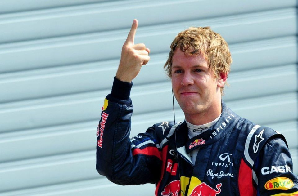 Germany's Sebastian Vettel on pole for Red Bull in Italy