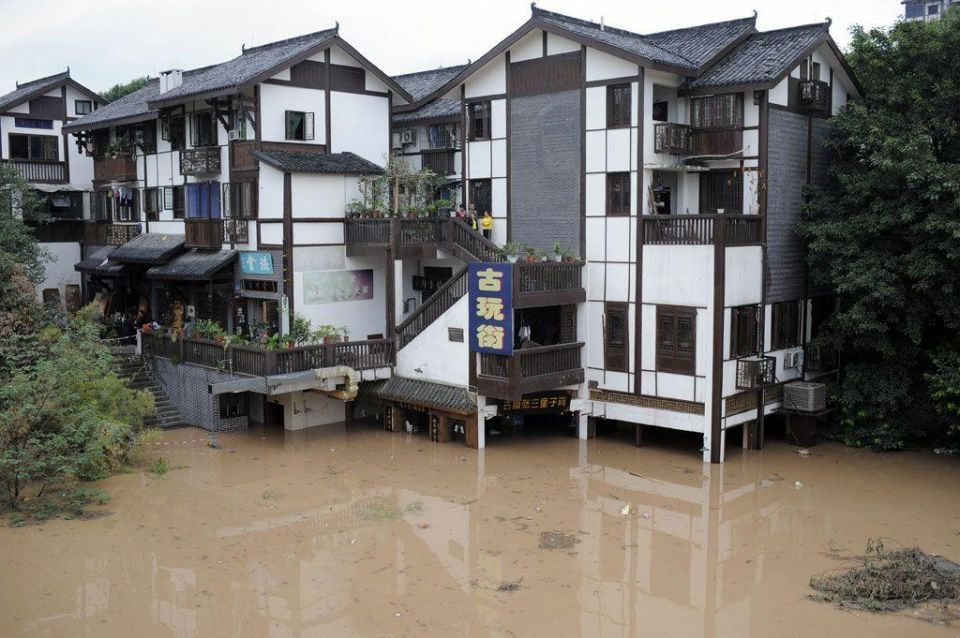 Floodwaters overturn restaurant boat in southwestern China