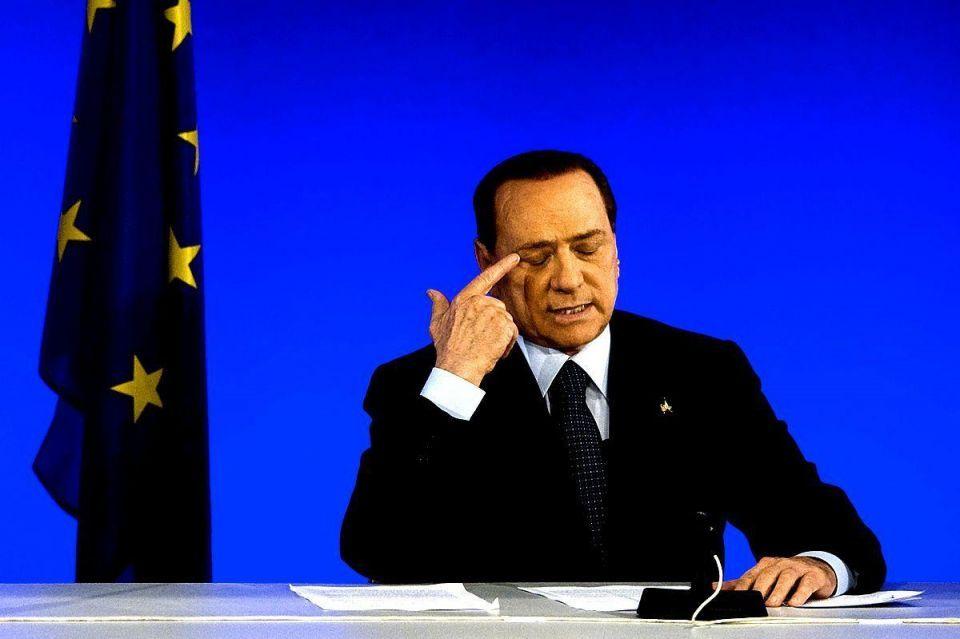 Italy's Berlusconi faces crunch vote, pressure to quit