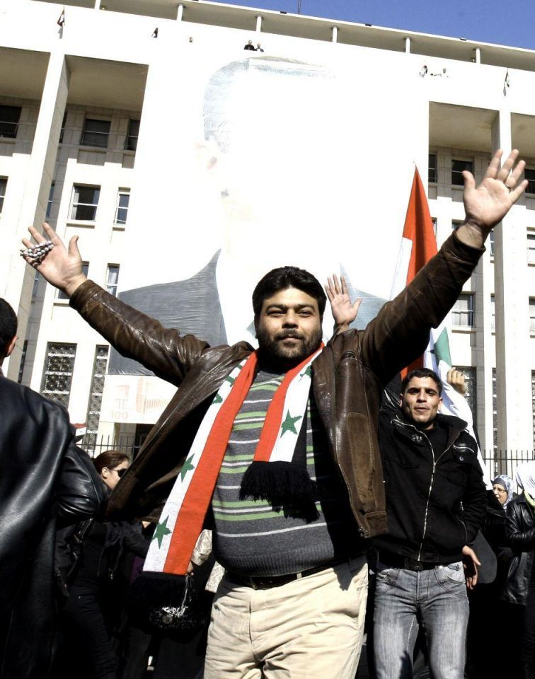 Syrians take to streets over Arab League sanctions