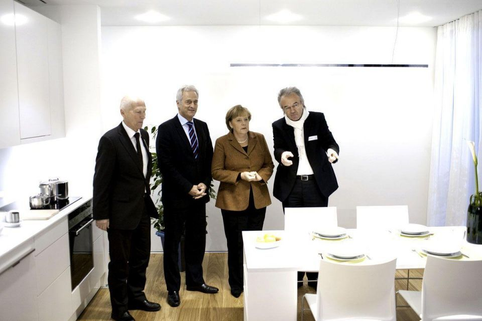 Merkel takes wraps off house that can also drive a car