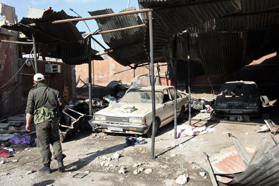 Suicide bombers hit Syrian security buildings, killing 40