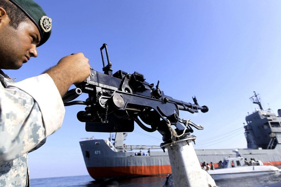 Iran warns US warship to leave area of naval exercise