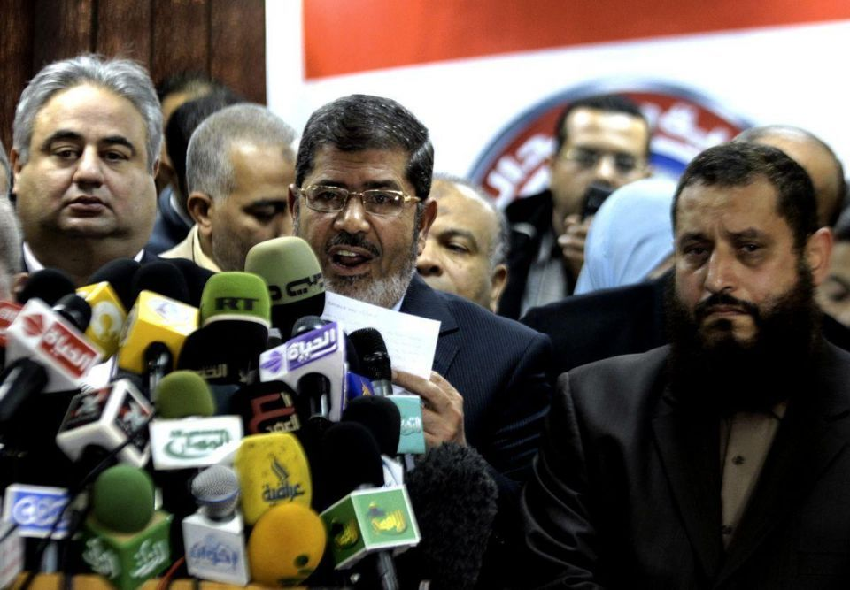 Mursi decree stirs debate on Brotherhood role