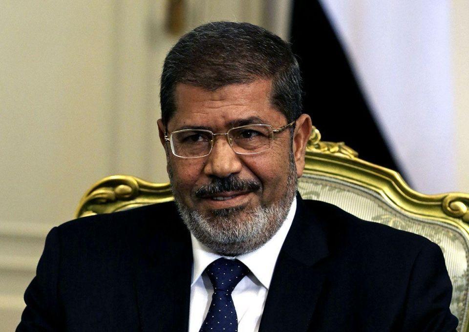 Egypt's Mursi invites opposition to election talks