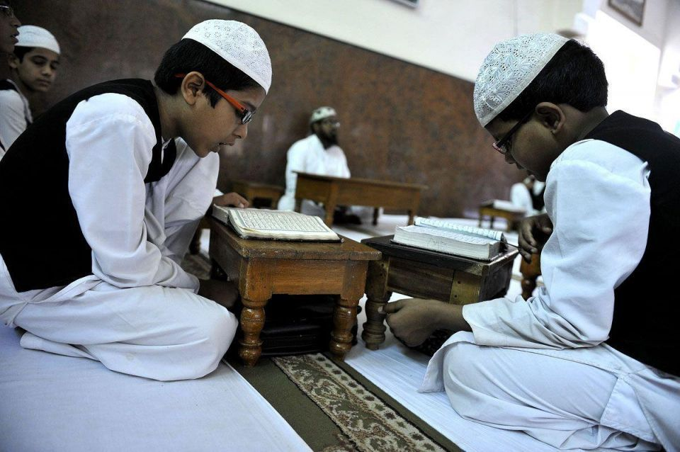 Indian Muslim students recite the Holy Qur'an
