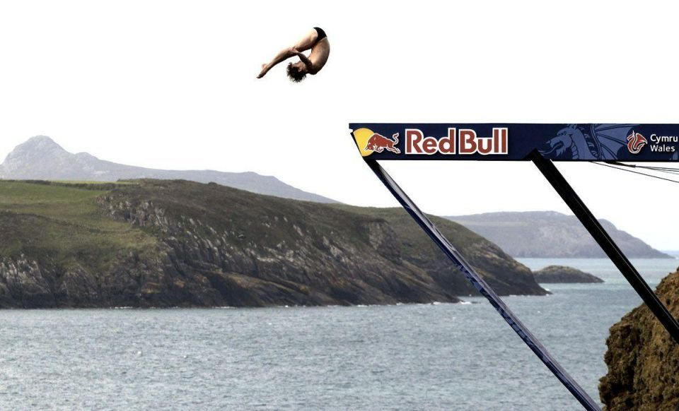 Contestants participate in the Red Bull cliff diving competition