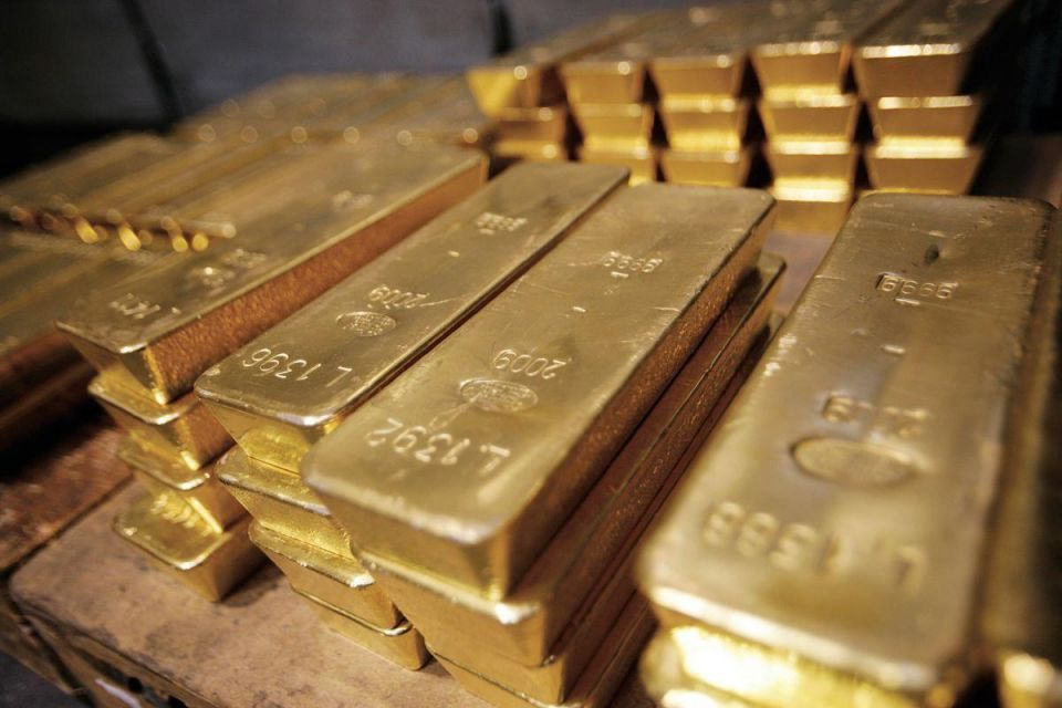 Gold up on soft dollar after concerns about Fed allayed