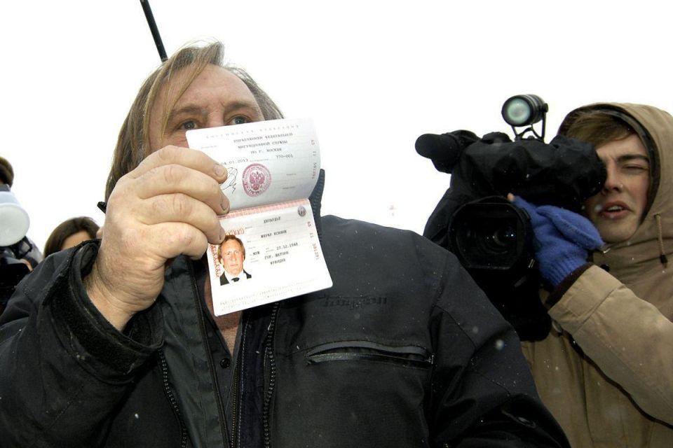 Gerard Depardieu receives a Russian passport from President Vladimir Putin