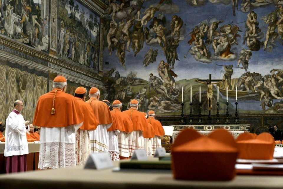 Cardinals enter the Sistine Chapel for the Conclave