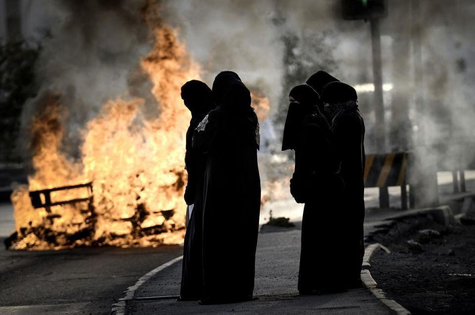 Bahrain jails 50 for ties to anti-government group - activists