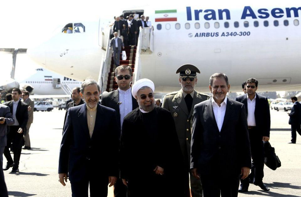 Rouhani returns to Iran from UN