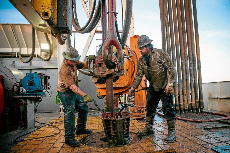 Oil hit multi-month lows on record OPEC output