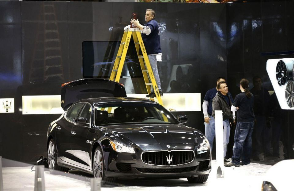 Workers prepare for Chicago Auto Show