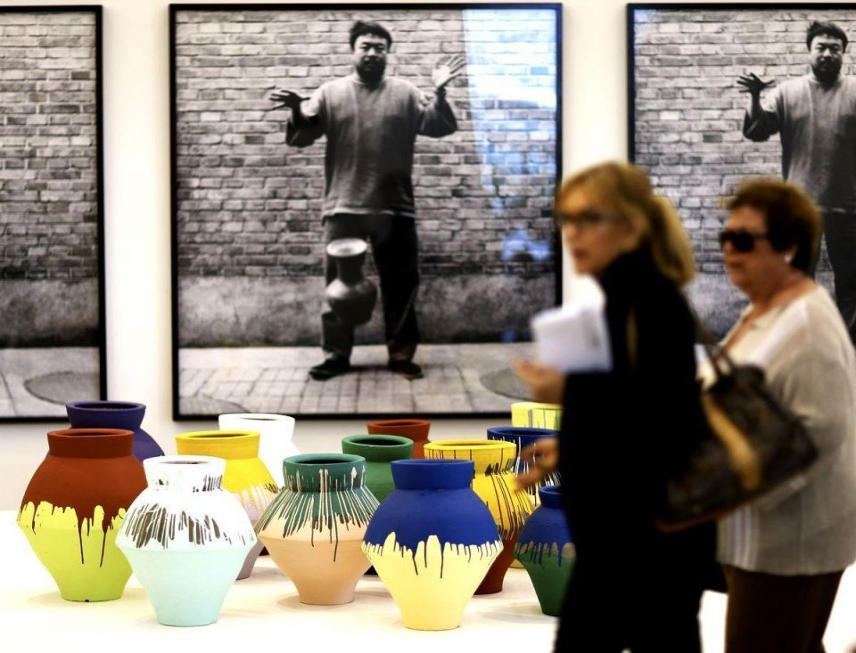 Artist smashes $1m vase in protest