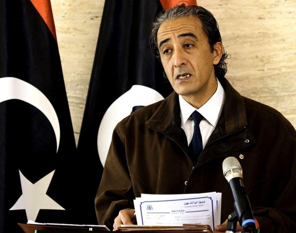 Libya struggles to pay bills as protests slash oil revenues