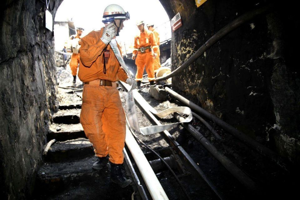 22 trapped in coal mine flood