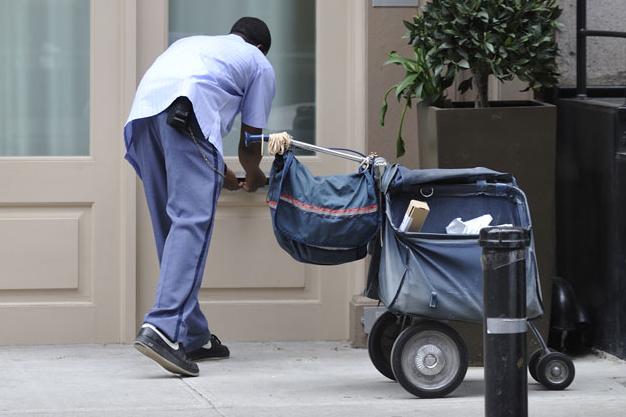 """Bahrain mulls """"danger"""" pay for postmen"""