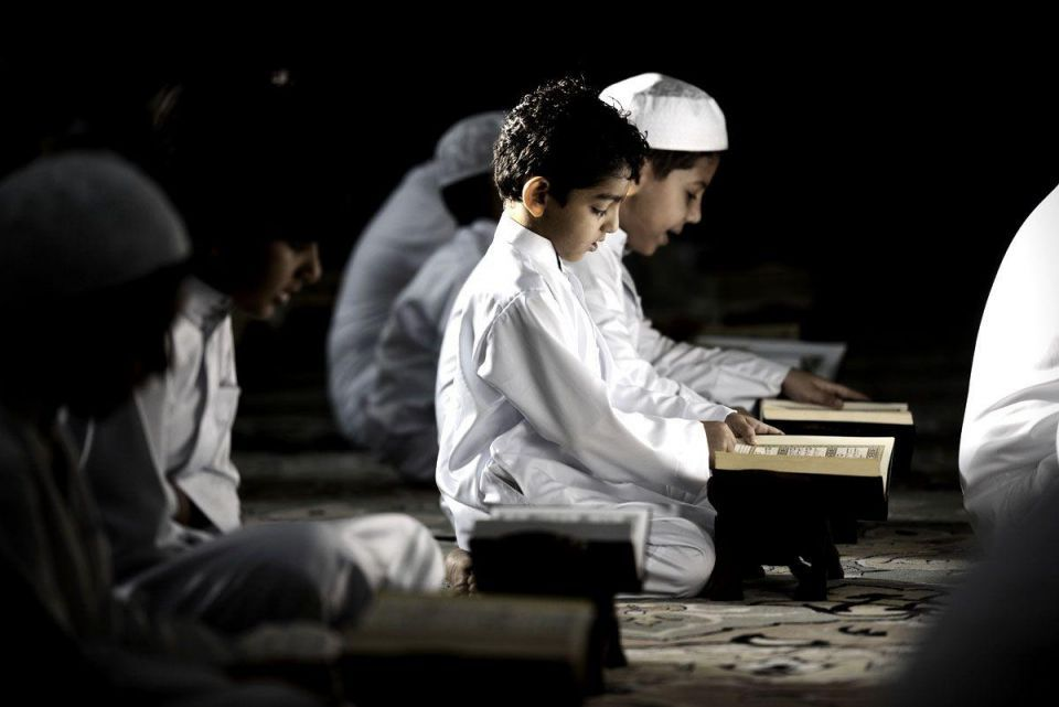 Bahraini Shiite Muslim boys read the Koran