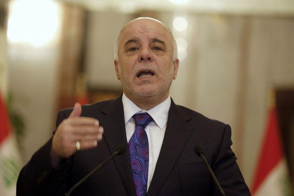 Iraq's Abadi forming new government amid unprecedented security crisis