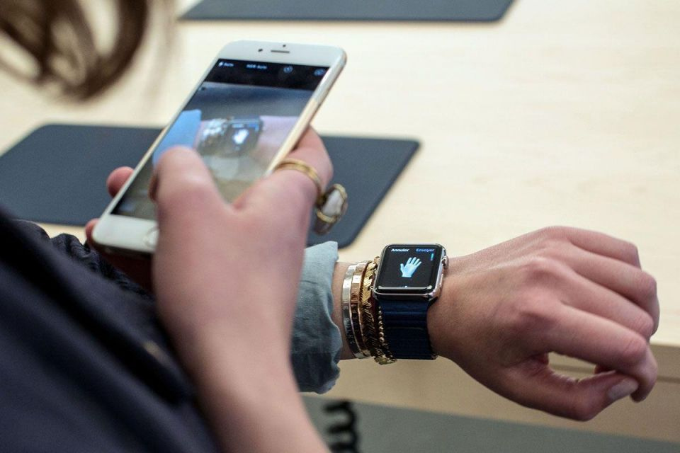 Apple's quarterly earnings buoyed by strong iPhone sales