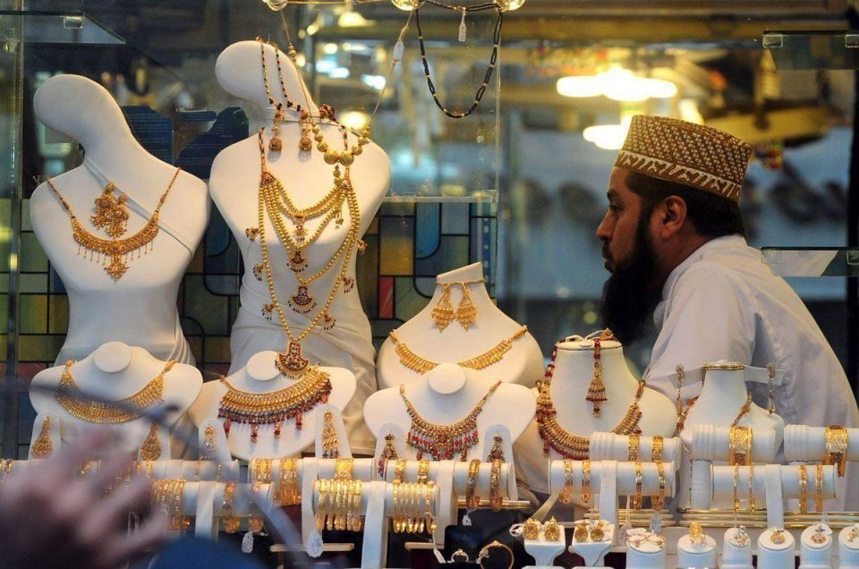 Gold slips on firmer dollar, no benefit from equities fall