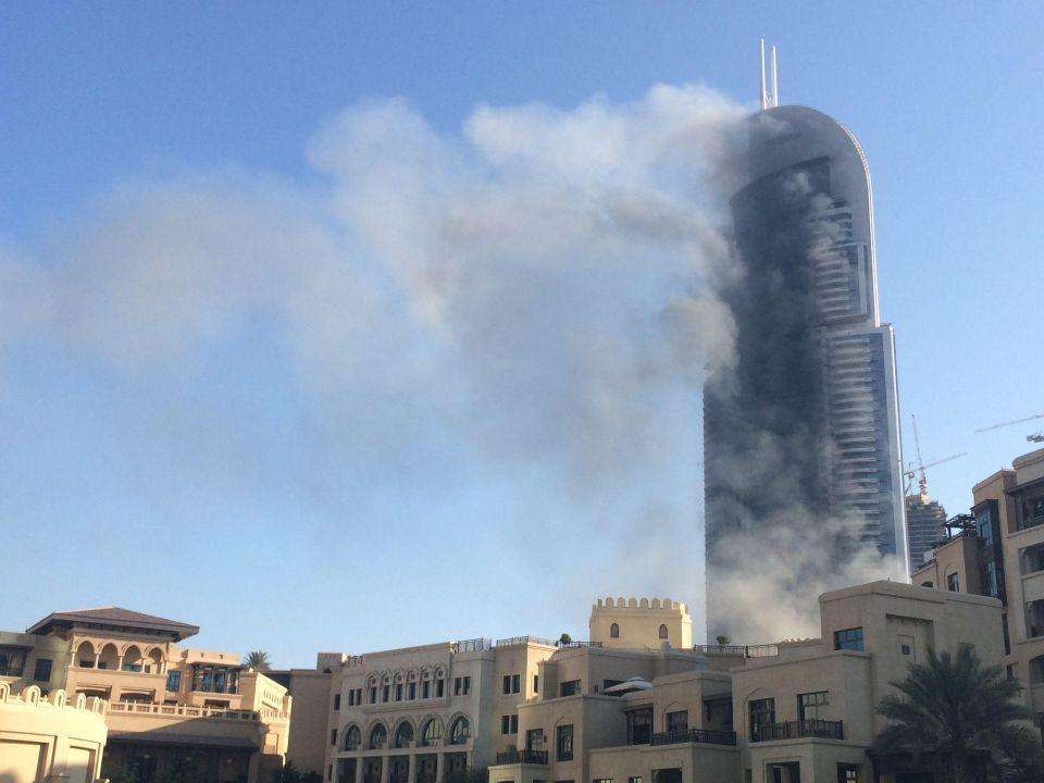 Firefighters struggle to extinguish Dubai hotel blaze
