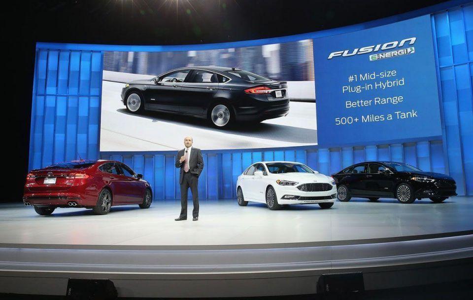 Car makers reveal new models in Detroit