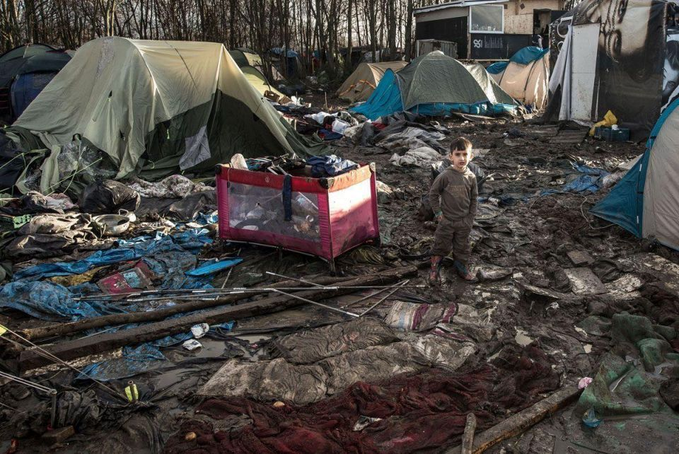 """Hell on earth is here"": the squalid conditions facing Arab refugees as they spend winter in a makeshift camp in France"