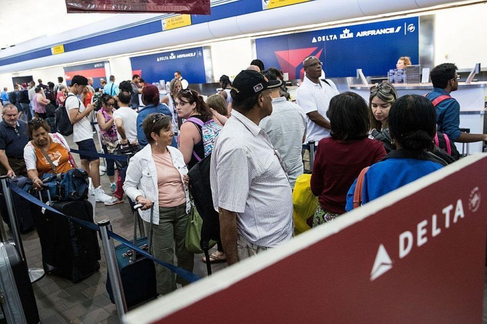 In pictures: Power outage strands Delta Airlines operations worldwide