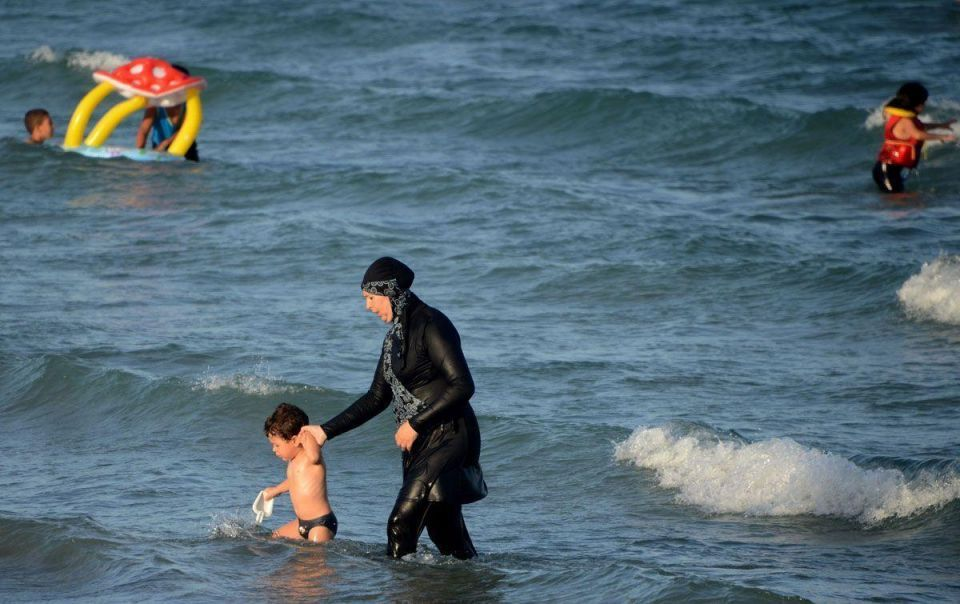 Woman ordered to remove top and headscarf on French beach