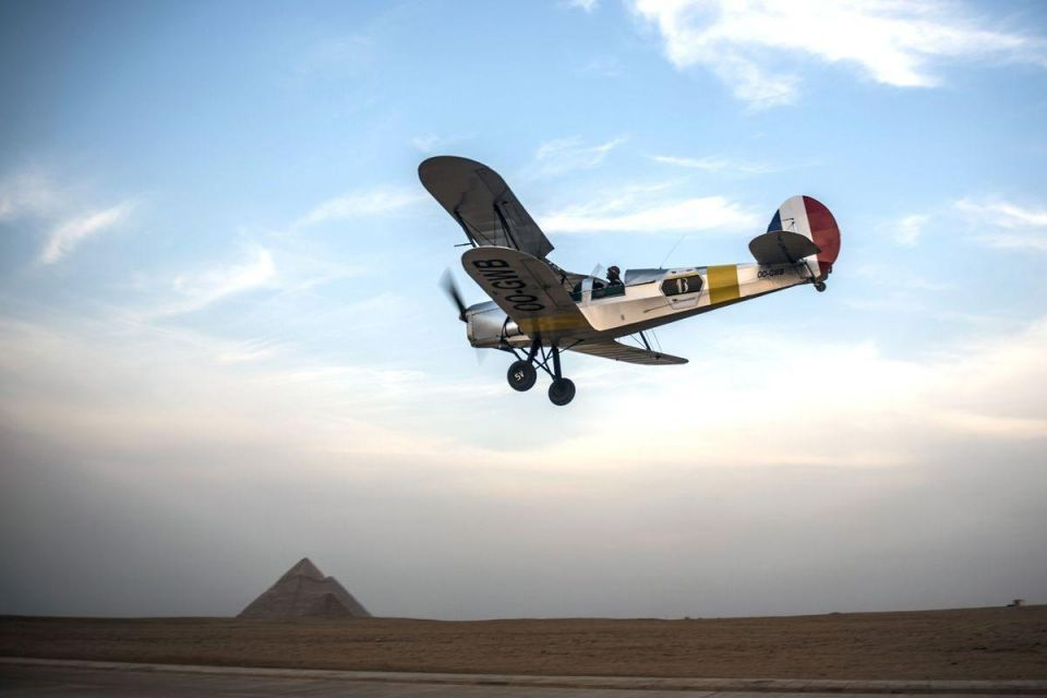 In pictures: Vintage biplanes fly near the Pyramids of Giza in Egypt