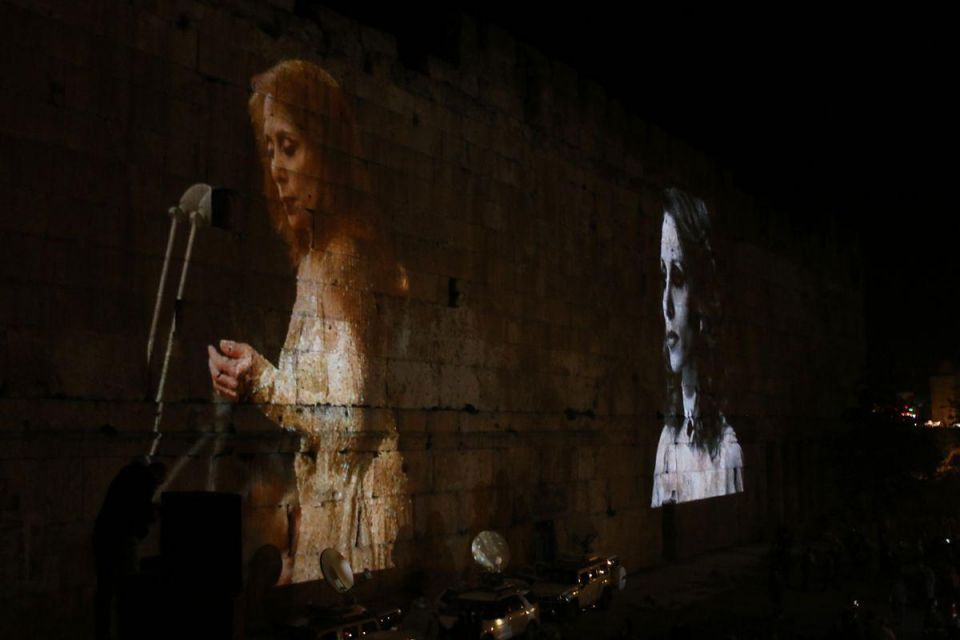 In pictures: UNESCO world heritage site Baalbek illuminated with a portrait of Lebanese singer Fayrouz