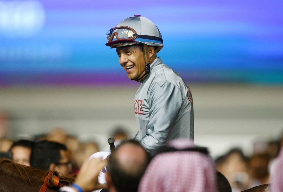 Victor Espinoza rides California Chrome to victory in the Dubai World Cup