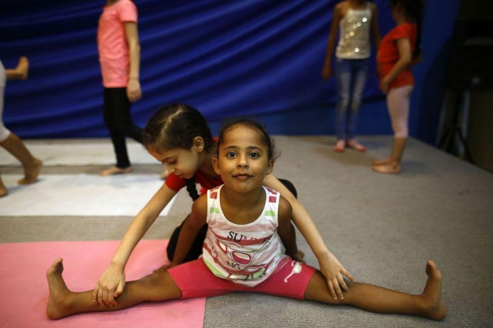 In pictures: Palestinian girls take part in an acrobatics class