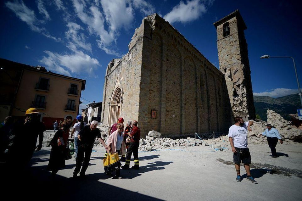 Italy rescuers toil through night as earthquake death toll rises to 247