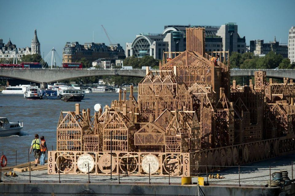 In pictures: Sculpture of 17th century London skyline is put into place on the River Thames