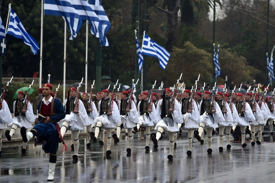 Greeks celebrate Independence Day as EU creditors discuss their fate